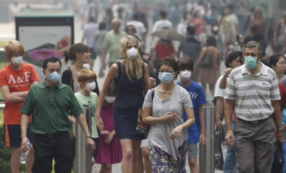 Singapore suffocates in the haze (photo-Reuters)