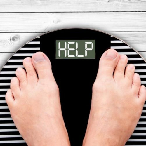 feet-on-scales-saying-help